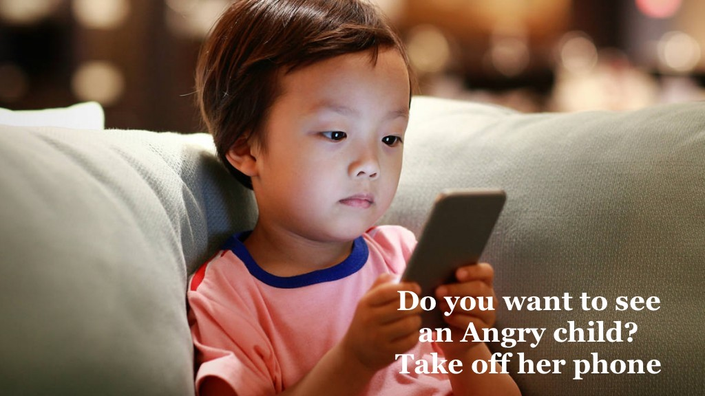 little-boy-looking-at-phone-on-couch-1024x576-1515610949